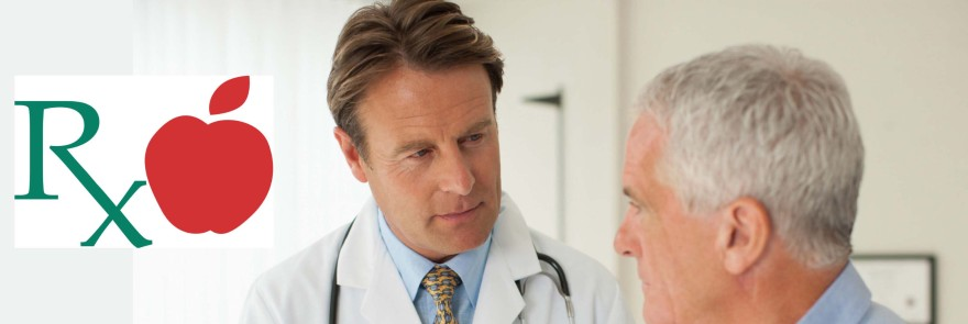 Male dr talks with male pt