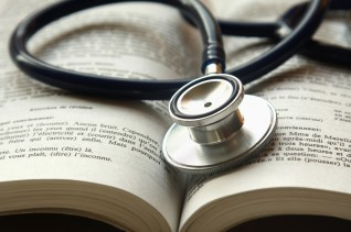 Medical journal with stethoscope